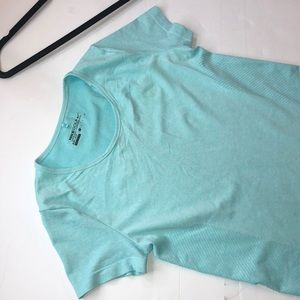 Woman's Nike golf shirt , Color blue,size small
